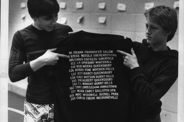 Ballston Spa High School, New York - Frank Fronhoffer, 91 pounds from Salem, on right, and Steve Mitola, 98 pounds, from Shenendehowa, hold up section 2 champ shirt. February 26, 1987 (Paul D. Kniskern/Times Union Archive)