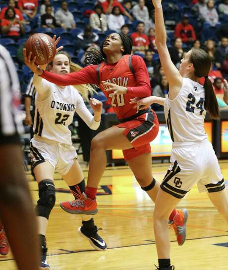 Judson's Kierra Sanderlin (20) goes into the paint to score against O'Connor's Errolyn Slaugh (24) during their Region IV Regional Quarterfinals game at UTSA on Tuesday, Feb. 25, 2020. Judson defeated O'Connor, 44-28, to continue in the playoffs.