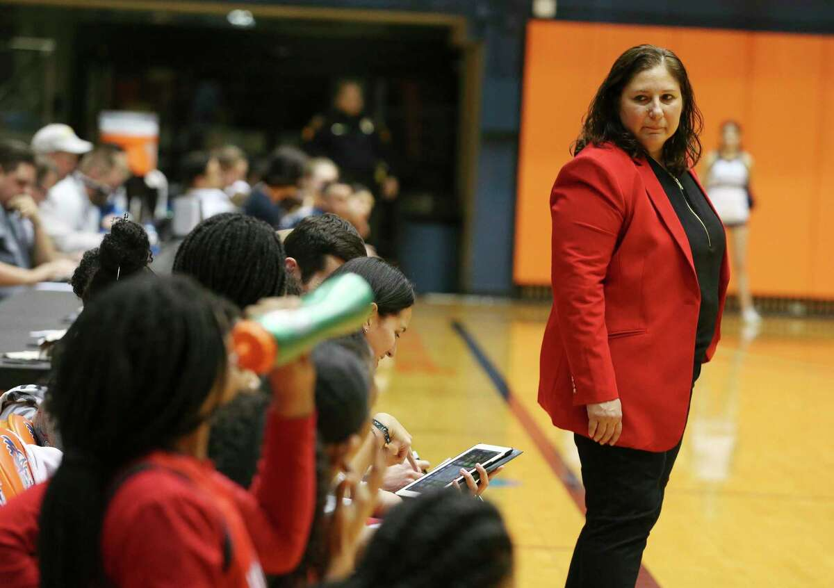Judson coach Triva Corrales (right) looks back at her team in the closing moments of the game against O'Connor during their Region IV Regional Quarterfinals game at UTSA on Tuesday, Feb. 25, 2020. The Rockets defeated the Panthers, 44-28, to continue in the playoffs.