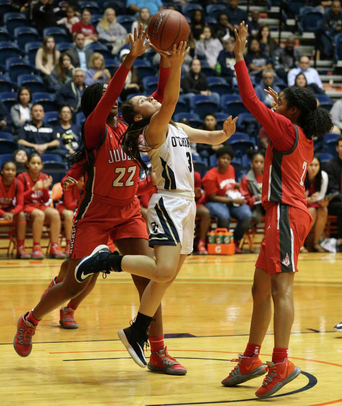 O'Connor's Julianna Tapia (03) attempts a score against Judson's Amira Mabry (22) and Teanna Huggins (02) during their Region IV Regional Quarterfinals game at UTSA on Tuesday, Feb. 25, 2020.
