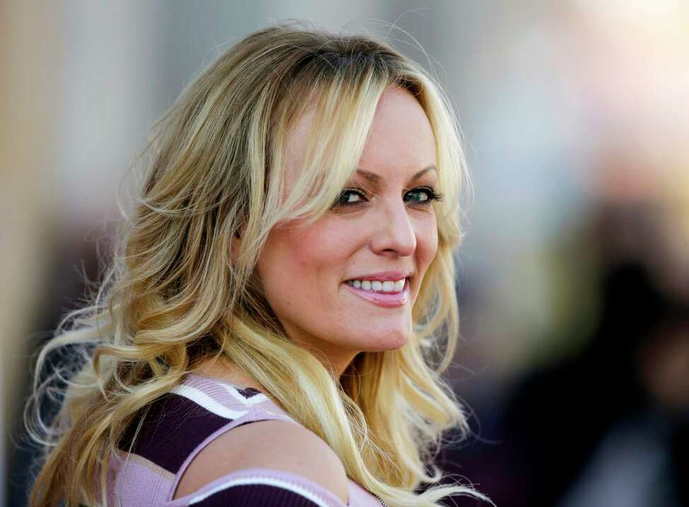 FILE - In this Oct. 11, 2018, file photo, adult film actress Stormy Daniels attends the opening of the adult entertainment fair 'Venus' in Berlin, Germany. Ohioa€™s capital city has reached a $450,000 settlement with Stormy Daniels over the porn actressa€™ arrest at a strip club last year. Her federal defamation lawsuit against several Columbus officers alleged officers conspired to retaliate against her over her claims that she had sex with Donald Trump before he became president. (AP Photo/Markus Schreiber, File)