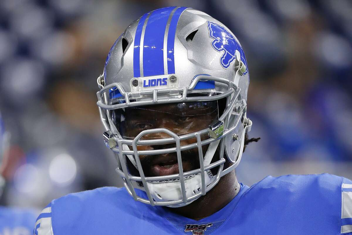 FILE - In this Aug. 23, 2019, file photo, Detroit Lions defensive tackle Damon Harrison warms up before an NFL preseason football game against the Buffalo Bills in Detroit. The Detroit Lions have released defensive tackle Damon