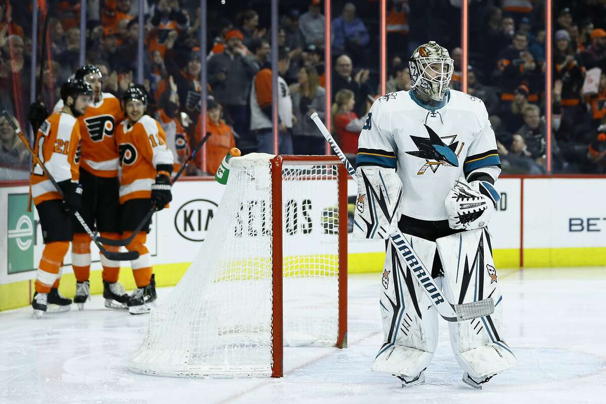 San Jose Sharks' Aaron Dell, right, reacts after giving up a goal to Philadelphia Flyers' Kevin Hayes during the second period of an NHL hockey game, Tuesday, Feb. 25, 2020, in Philadelphia. (AP Photo/Matt Slocum)