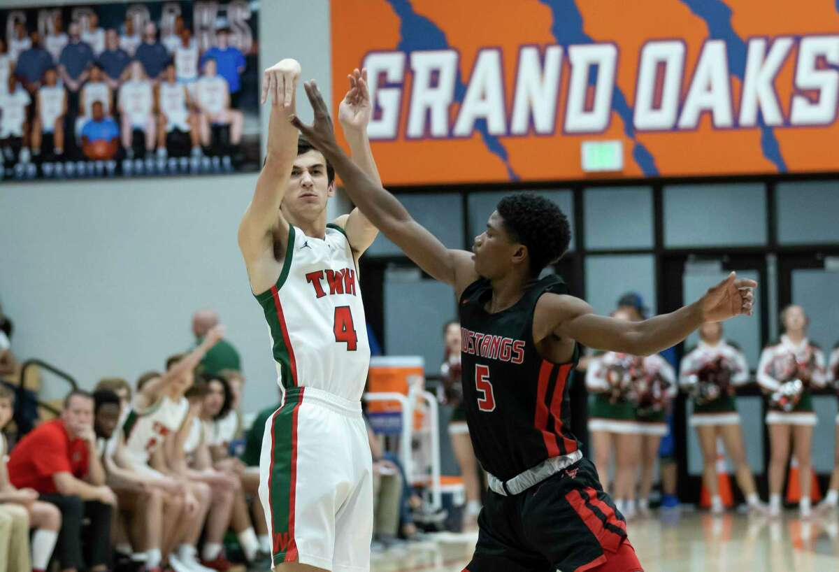 Woodlands guard Peyton Mattingly (4) shoots for a 3-pointer while under pressure from Westfield shooting guard Tre Jackson (5) during the first half in a Region II-6A area boys basketball playoff at Grand Oaks high school, Tuesday, Feb. 25, 2020.