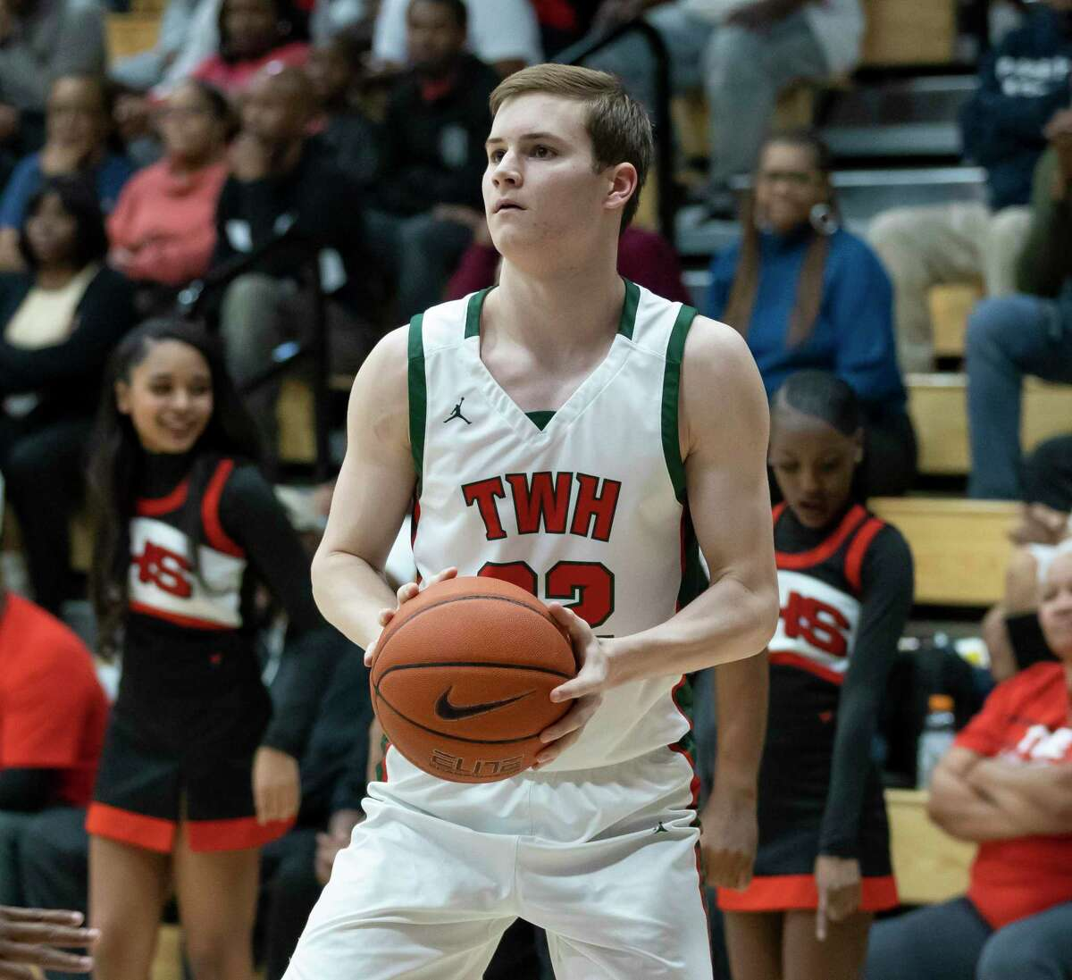 Woodlands guard Brock Luechtefeld (22) shoots for a 3-pointer during the first half in a Region II-6A area boys basketball playoff against Westfield High School at Grand Oaks high school, Tuesday, Feb. 25, 2020.