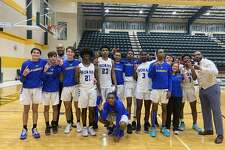 The Hamshire-Fannett Longhorns celebrate after their 32-30 bi-district win over Huffman-Hargrave on Tuesday night.