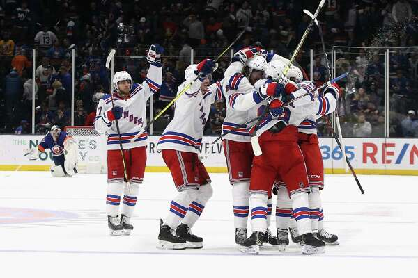NEW YORK, NEW YORK - FEBRUARY 25: The New York Rangers celebrate their 4-3 overtime win against the New York Islanders at NYCB Live's Nassau Coliseum on February 25, 2020 in Uniondale, New York. (Photo by Bruce Bennett/Getty Images)
