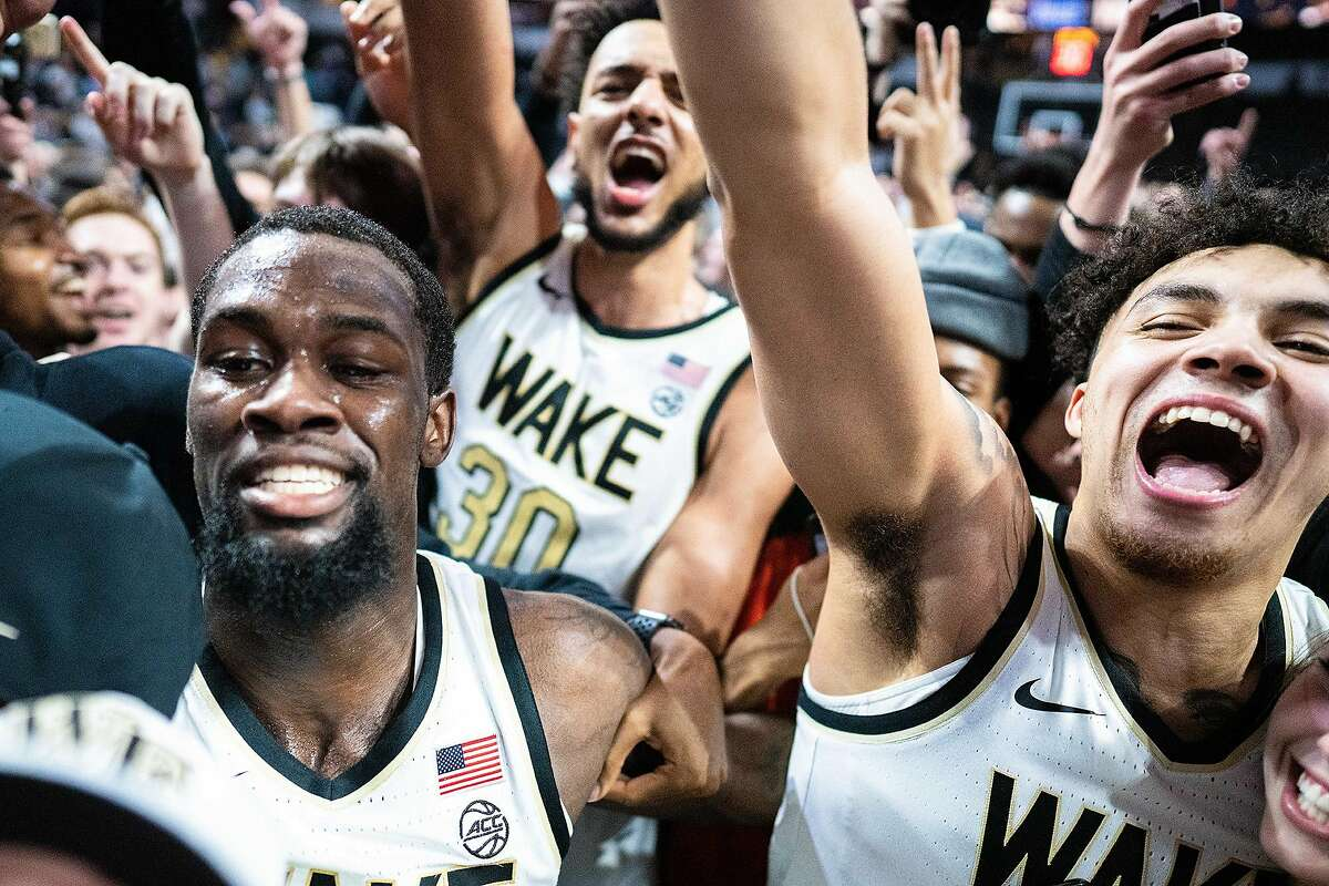 Wake Forest players and fans storm the court after a 113-101 double-overtime win against Duke at LJVM Coliseum Complex in Winston-Salem, N.C., on Tuesday, Feb. 25, 2020. (Jacob Kupferman/Getty Images/TNS)