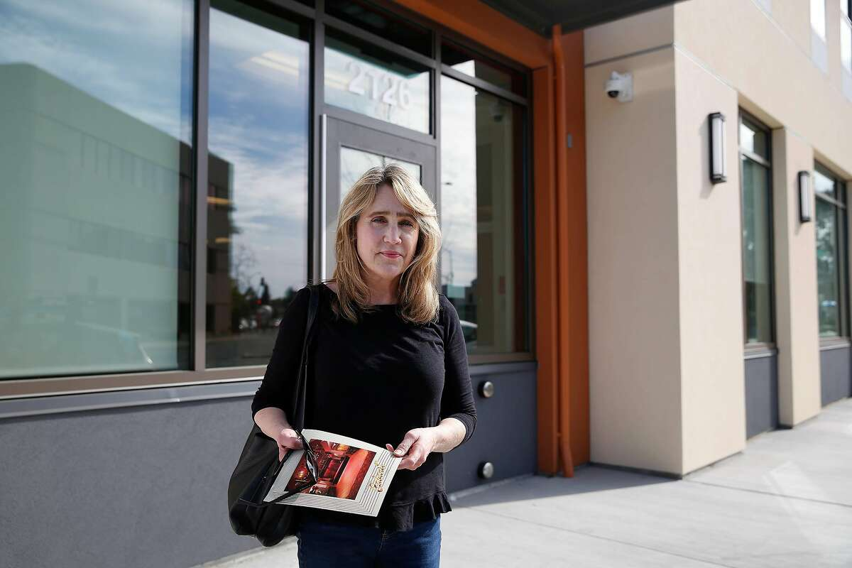 Martha Rosenquist stands for a portrait outside the Embark Apartments on Friday, February 21, 2020 in Oakland, Calif. Martha Rosenquist found Gary Rosenquist, her husband, deceased on February 1 in their RV where they were living. She was hoping to move into the Embark Apartments with him this month, but since he's passed away, Veteran Affairs has rescinded her reservation. .