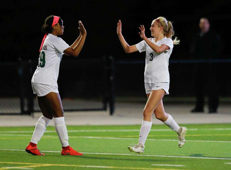 In this file photo, The Woodlands midfielder Courtney Koehler (3) gets a high-five from forward Samone Knight (29) after scoring a goal during the first period of a District 15-6A high school soccer match at Woodforest Bank Stadium, Friday, Jan. 24, 2020, in Shenandoah. Photo: Jason Fochtman, Houston Chronicle / Staff Photographer / Houston Chronicle © 2020