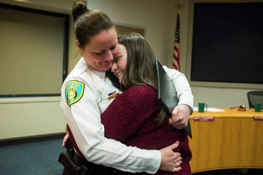 City of Midland Police Chief Nicole Ford hugs her daughter, Mackenzie Ford, 19, after a swearing-in ceremony for Ford on Monday at City Hall. Ford is the first woman to serve as Police Chief in Midland. For more photos, go to www.ourmidland.com. (Katy Kildee/kkildee@mdn.net)