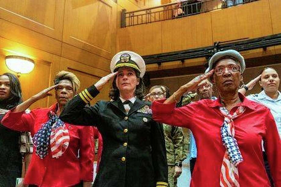 Women veterans of every branch of the U.S. military salute Tuesday as the national anthem is sung in an auditorium at the Pritzker Military Museum and Library in Chicago ahead of the announcement of the first all women honor flight later this year to Washington, D.C. Photo: Tyler LaRiviere | Chicago Sun-Times Via AP