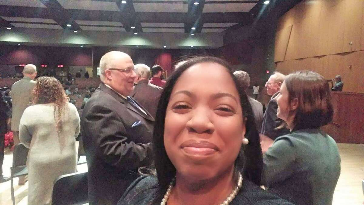 Town Councilman Joy Colon snaps a selfie at the Trumbull swearing-in ceremony Dec. 4 2019.