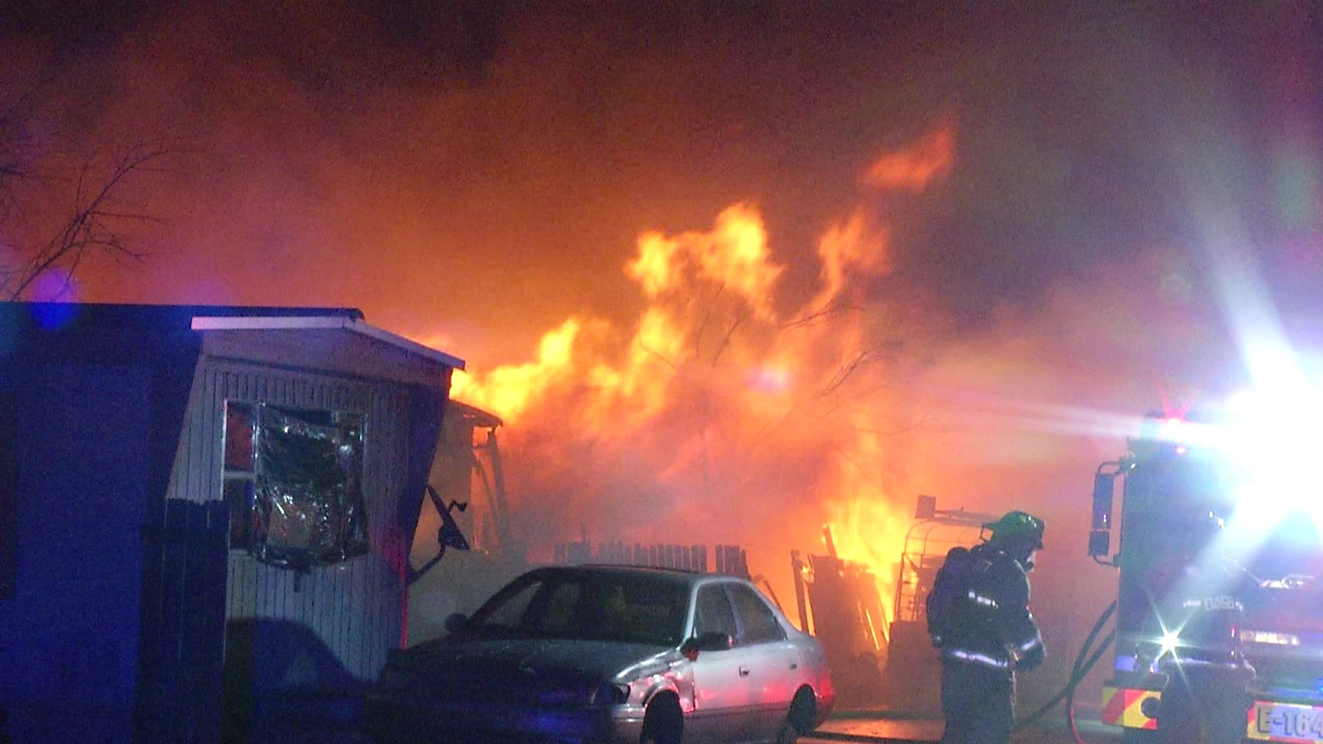 Arson believed to be cause of multiple-trailer fire, person of interest ID'd, officials say
