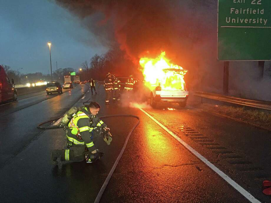 A vehicle on southbound I-95 in Fairfield caused heavy delays on Wednesday, Feb. 26, 2020. The vehicle was located in the right breakdown lane and was fully involved when Fairfield firefighters arrived on scene. The owner reported the check engine light had gone on in his Volvo SUV and immediately after he noticed fire in the engine compartment. With the help of a UConn police officer on his way to work at the Stamford UConn Campus, the driver removed his personal belongings from the car and waited for firefighters to arrive. Photo: Fairfield Fire Department Photo