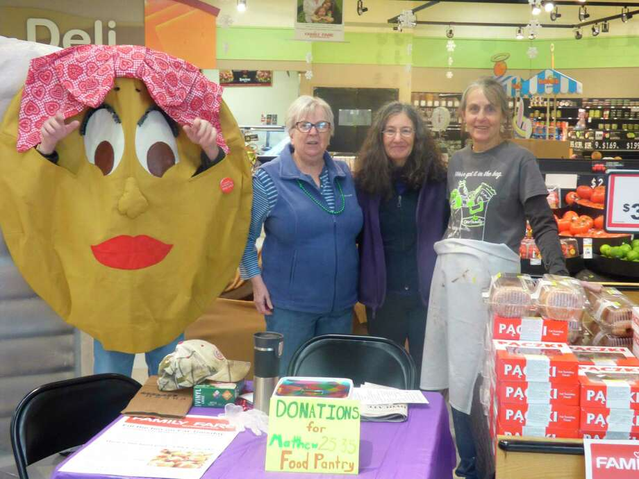 """The Matthew 25:35 Food Pantry volunteers host the annual """"Pack the Paczki"""" food drive at Family Fare in Manistee to raise food for the pantry. (Scott Fraley/News Advocate)"""