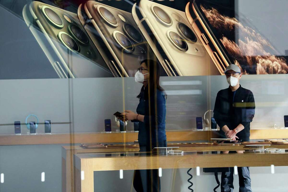 Employees wear face masks at Apple Store in Beijing on February 17, 2020 in Beijing, China. Fearing a virus outbreak, Apple closed all stores in China on February 1. Those stores have begun to reopen as the virus subsides in Greater China.