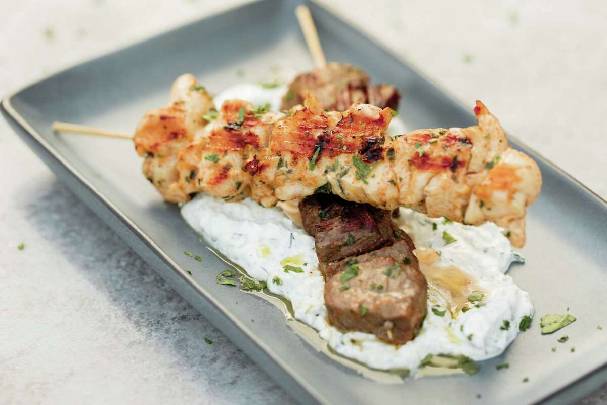 Snack-sized and portable: Grilled petite filet and chicken skewers with Sicilian garlic yogurt and olive oil at Postino WineCafe restaurants in the Heights and Montrose.