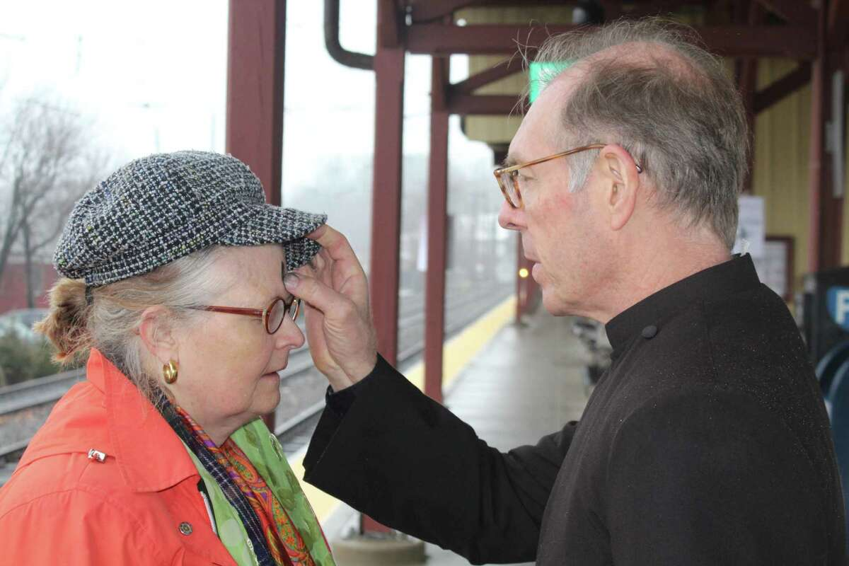 Mary Regan of New Canaan receives ashes from the Rev. Peter Walsh of St. Mark's Episcopal Church in New Canaan to start her Ash Wednesday. St. Mark's has offered Ashes to Go to commuters at the downtown New Canaan train station for several years, Walsh said.
