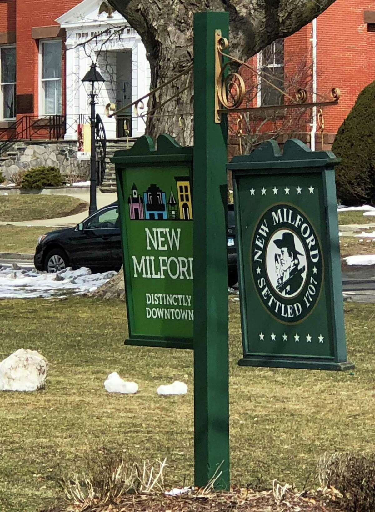 New Milford signs on Village Green, with Roger Sherman Town Hall in background.