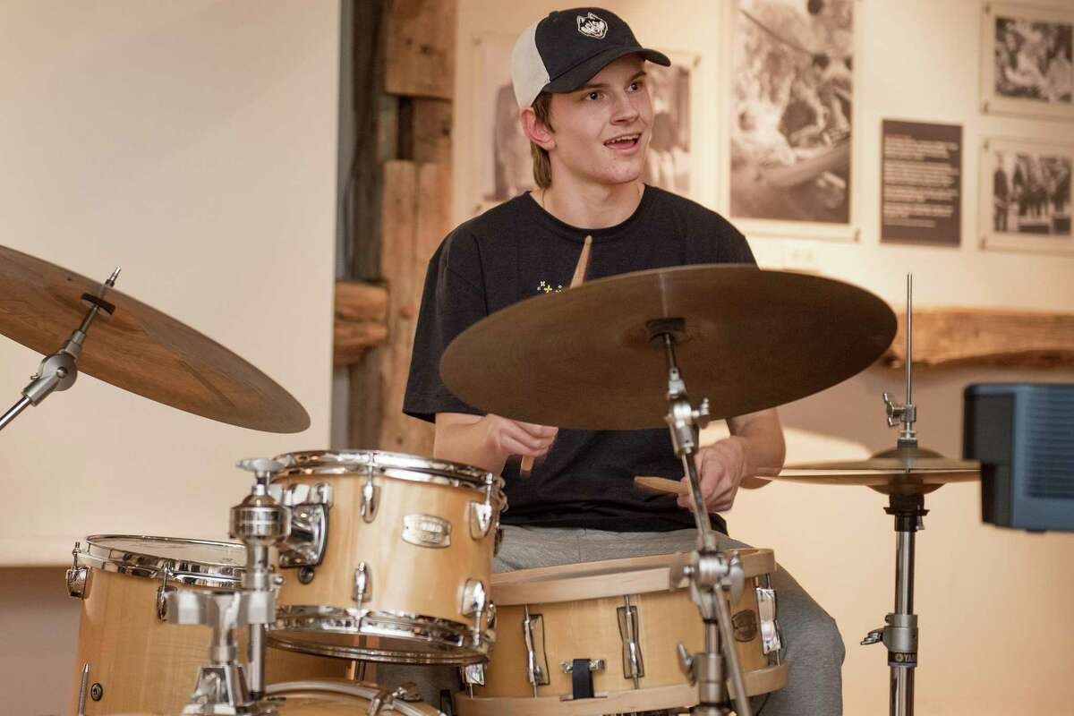 Mattias Onnerud of the Wilton High School jazz band played the drums at the Wilton Historical Society earlier this year. Next fall, the high school will offer a new music course for students who play percussion instruments.