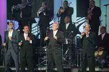 El Gran Combo perform with Gilberto Santa Rosa and Victor Manuelle on stage in Florida in 2007.