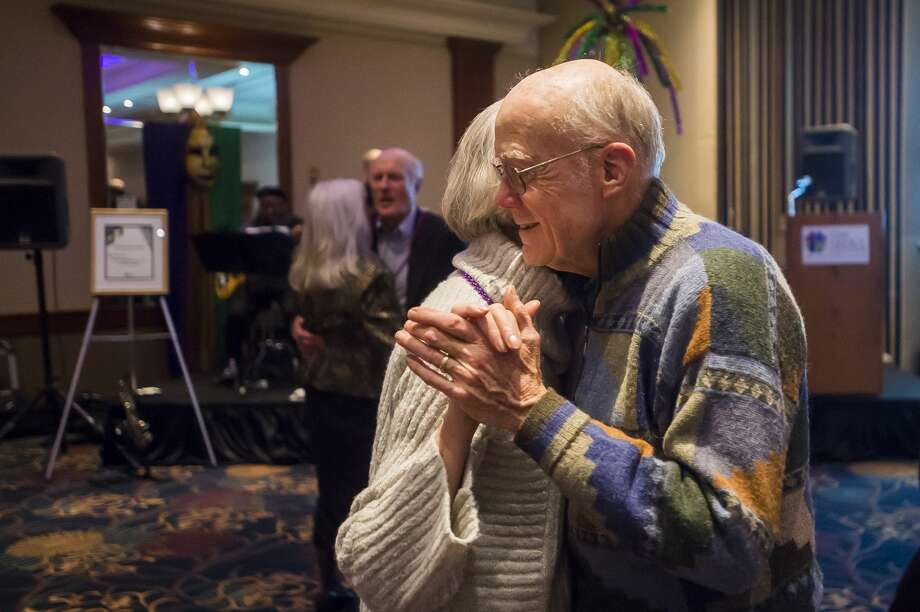 Duane Townley dances with Terry Townley during The Legacy Center's annual Mardi Gras Feast Tuesday, Feb. 25, 2020 at the Great Hall Banquet & Convention Center. (Katy Kildee/kkildee@mdn.net) Photo: (Katy Kildee/kkildee@mdn.net)