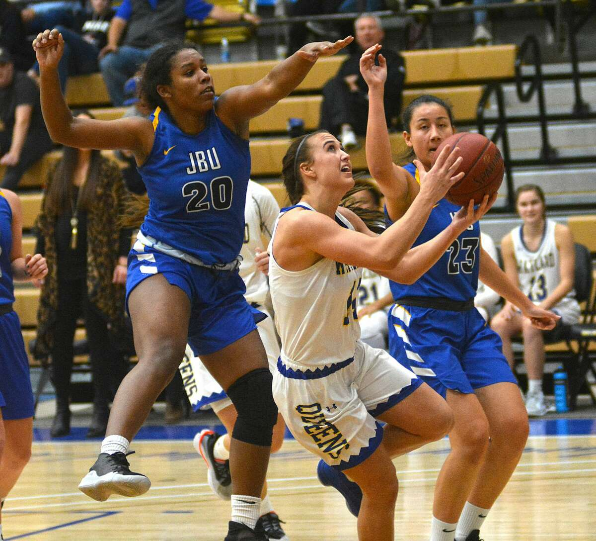 Wayland Baptist's Cailyn Breckel puts the shot up between John Brown defenders Haley James (20) and Liza Vanoverberghe during a Sooner Athletic Conference women's basketball game in the Hutcherson Center earlier this season.