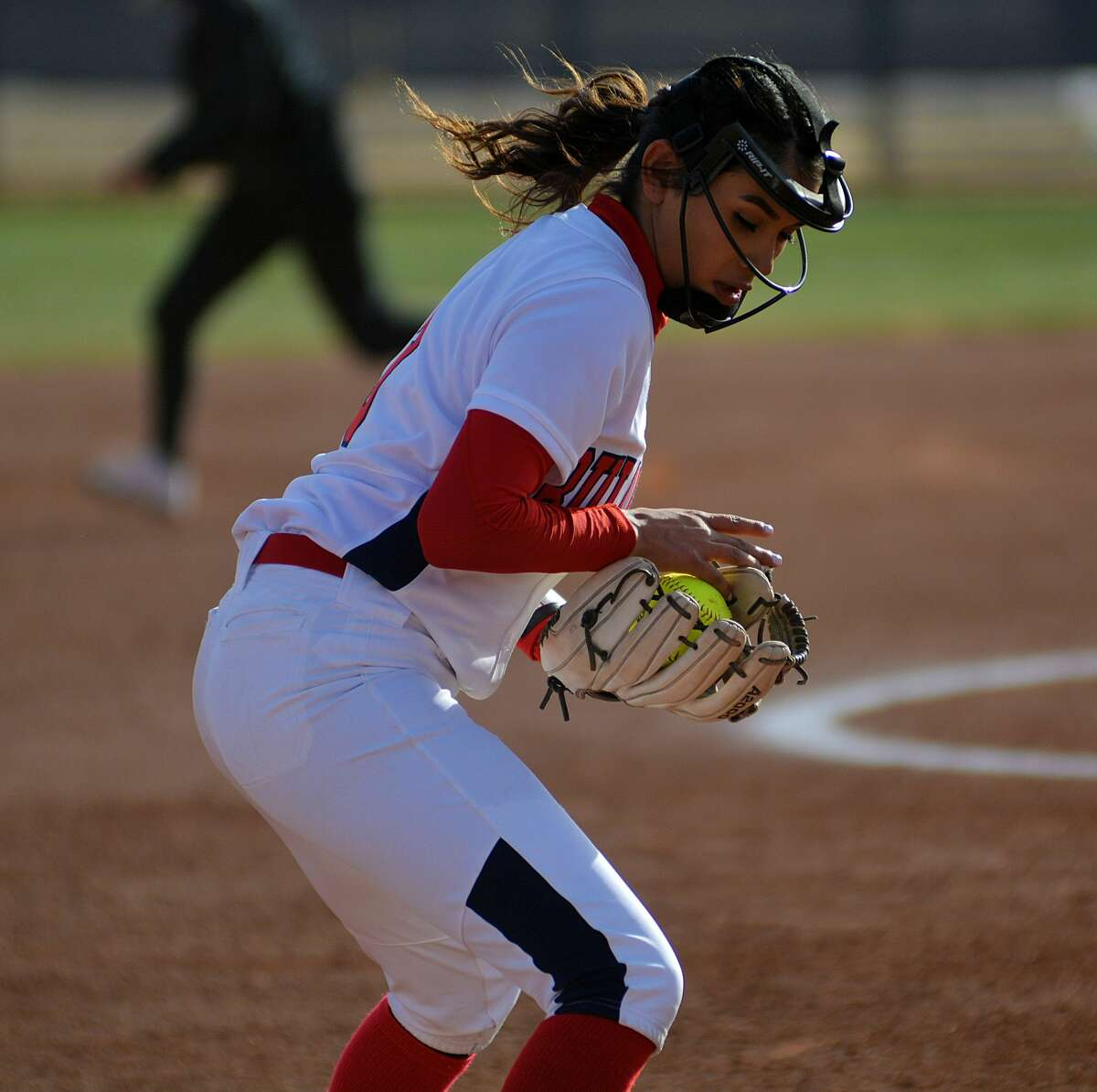 Plainview's Alexis Flores scoops up a grounder and steps on third base for the out during a District 3-5A softball game on Tuesday, Feb. 25, 2020 at Wilder Field.