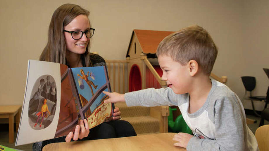 SIUE speech language pathology graduate student clinician Chelsey Short works with Holden, 4, during a therapy session in the Speech Language Hearing Center on campus.