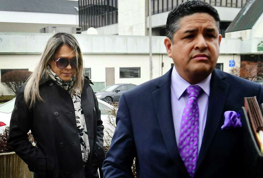 Norwalk resident Karoll Angelina Jurado-Hernandez, 46, left, arrives at Norwalk Superior Court with her attorney to answer charges of second-degree sexual assault and risk of injury to a minor Wednesday, February 26, 2020, at the court in Norwalk, Conn. She is accused of sexually assaulting a teen at her Norwalk beauty salon. Photo: Erik Trautmann / Hearst Connecticut Media / Norwalk Hour