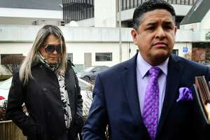 Norwalk resident Karoll Angelina Jurado-Hernandez, 46, left, arrives at Norwalk Superior Court with her attorney to answer charges of second-degree sexual assault and risk of injury to a minor Wednesday, February 26, 2020, at the court in Norwalk, Conn. She is accused of sexually assaulting a teen at her Norwalk beauty salon.
