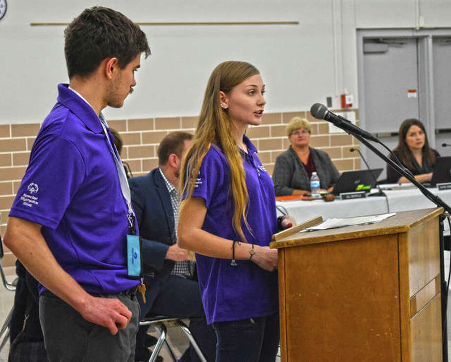 Edwardsville High School students and members of its Special Olympics Youth Activation Committee, Bre Cooper and Zack Gibbs, present to the school board on Monday night. Photo: Tyler Pletsch | The Intelligencer