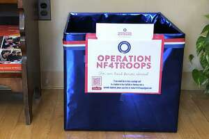 An Operation NF4Troops collection box at New Fairfield Town Hall.