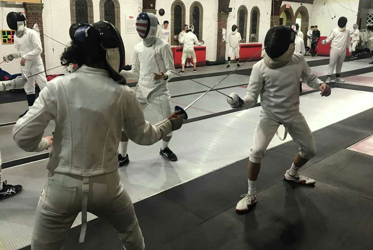Students at the Fairfield Fencing Academy facing off with the foil.