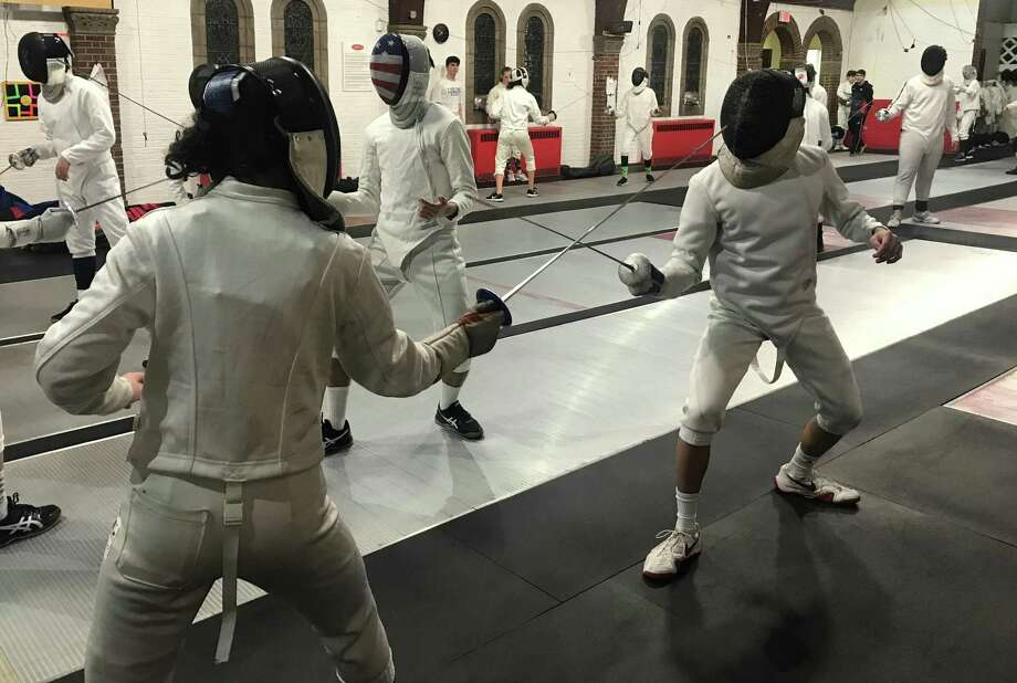 Students at the Fairfield Fencing Academy facing off with the foil. Photo: / Josh LaBella