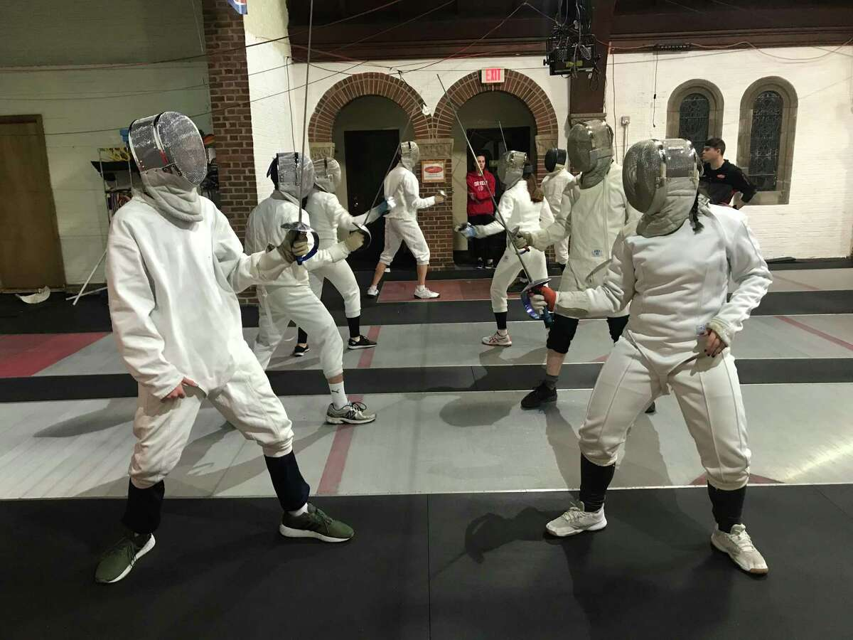 Students at the Fairtfield Fencing Academy sparring with sabres.
