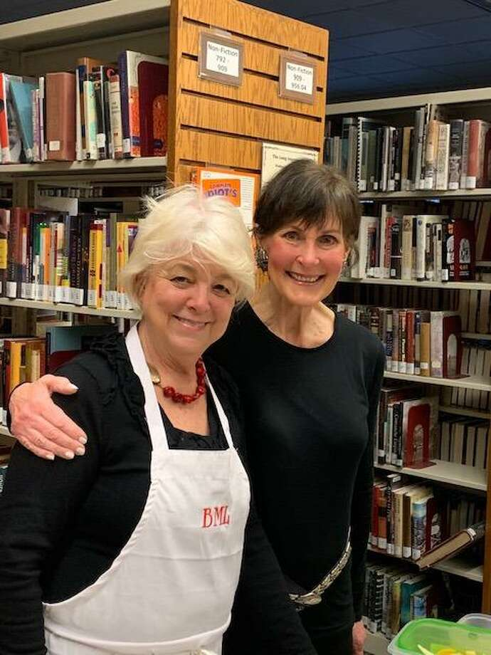Volunteers Elizabeth Adams and Debbie Karpf were among a dozen who helped make Brainerd Memorial Library's volunteer event a success. Photo: Donna Brinckerhoff / Contributed Photo