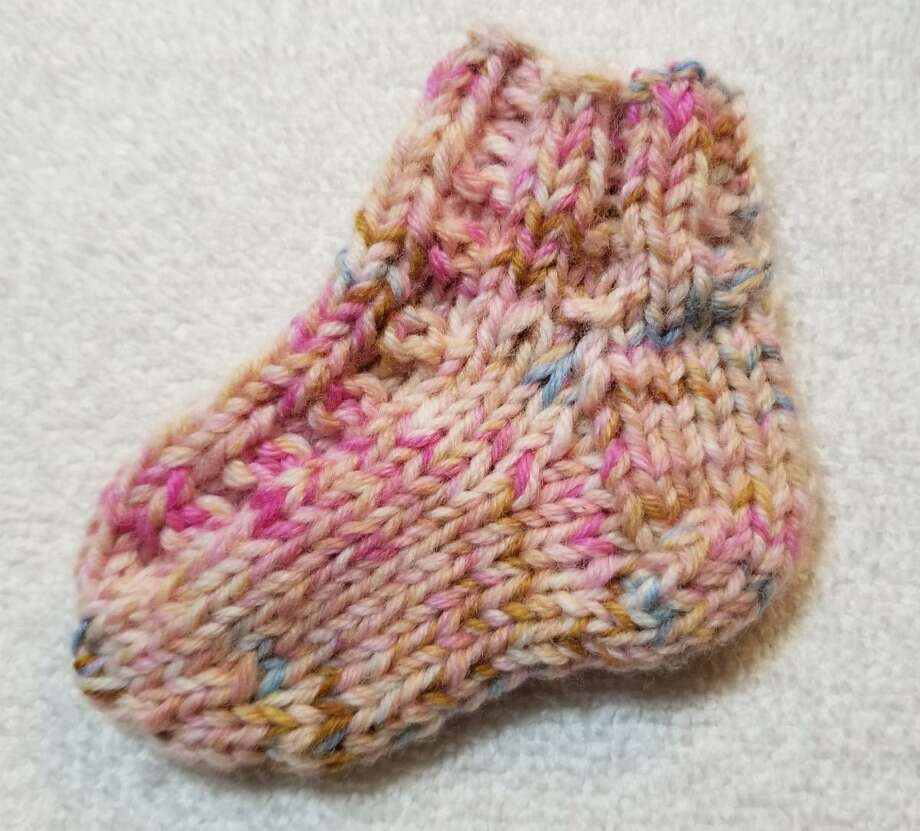 Socks can be an intimidating project for many knitters. Whether it's the fine weight sock yarn, using fiddly double point needles, or the stomach dropping turning of the heel, these all are reasons for knitters to avoid socks. Photo: Ginger Balch / Contributed Photo