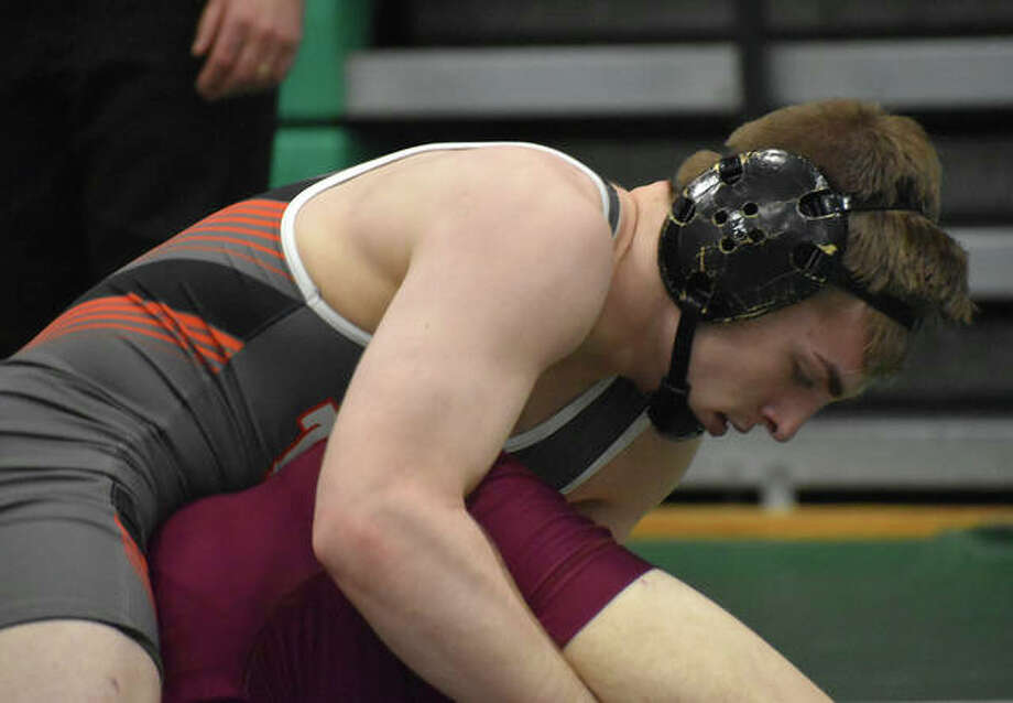 Edwardsville's Will Zupanci, top, tries to flip his Lockport opponent during the 152-pound match of the Class 3A Lincoln Dual Team Sectional. Photo: Matt Kamp|The Intelligencer
