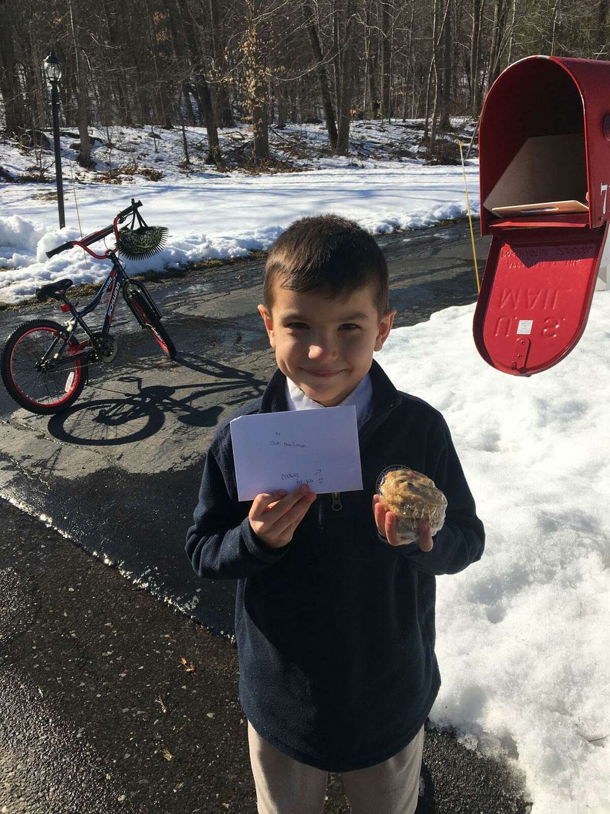 Third grade student and St. Catherine of Siena parishioner Sammy loves it when he gets presents in the mail. He made cookies to surprise his mailman.