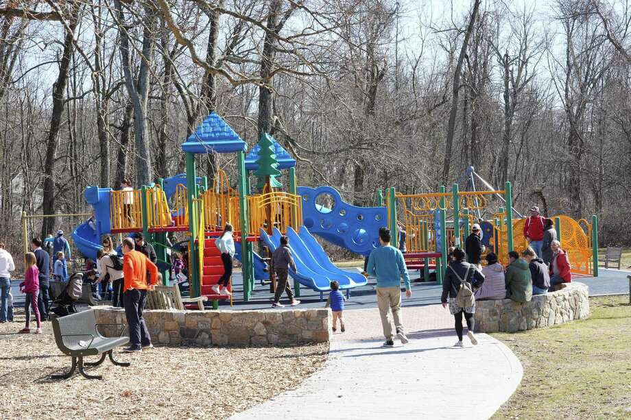 A spring-like day brought families out to the new playgrounds, such as the one here, at Mead Park in New Canaan recently. The park is one of many open in town, but the playground as all of them in town currently are, is closed in an effort to maintain social distancing. Photo: Grace Duffield / Hearst Connecticut Media.