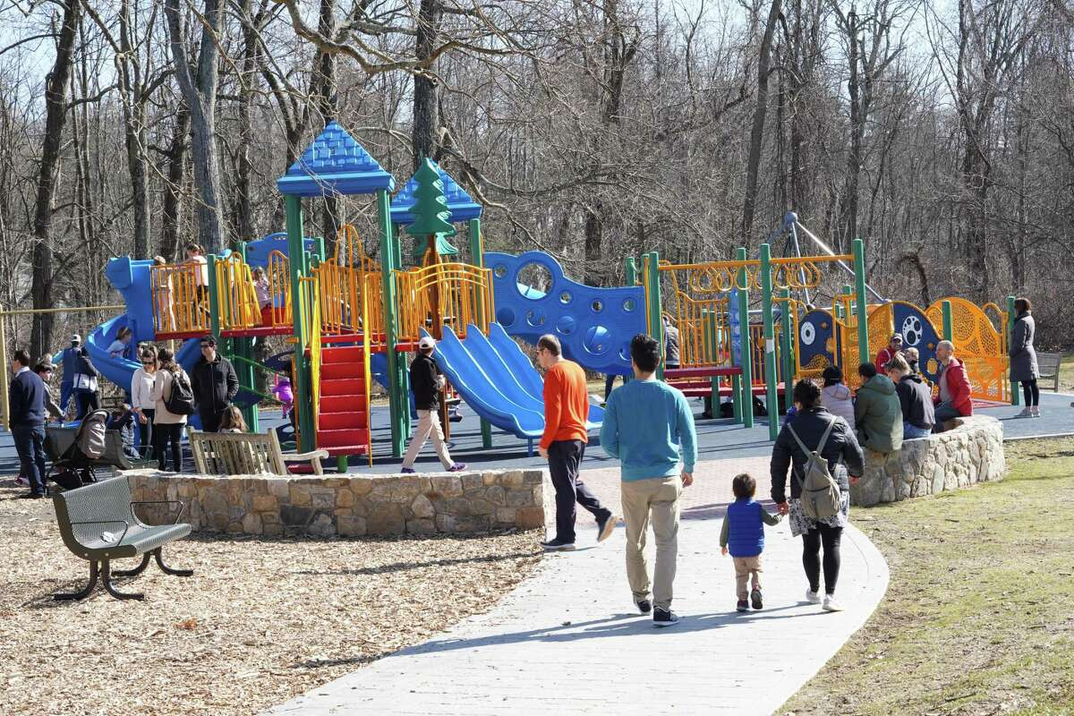 A spring-like day brought families out to the new playgrounds at Mead Park in New Canaan recently.