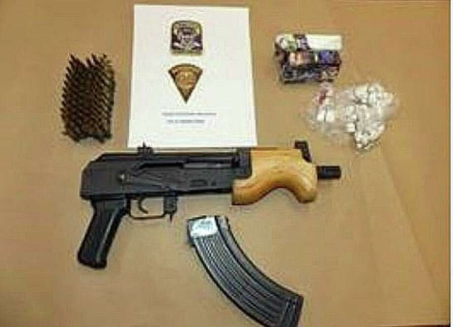 Two people were taken into custody Tuesday after a search of a Hamilton Street residence where narcotics and an illegally possessed firearm were seized. During the search of the residence, investigators found a loaded Micro Draco AK-47, with multiple rounds of ammunition, approximately 723 folds of packaged heroin which weighed approximately 217.2 grams, and drug packaging paraphernalia Photo: State Police Photo