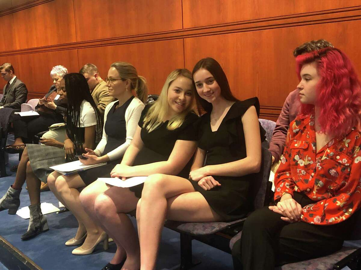 Students sit with state Senator Alex Bergstein, D-Greenwich, waiting to testify before the state's Public Health Committee in support of a bill that would require middle and high schools across the state to provide free feminine hygiene products in bathrooms.