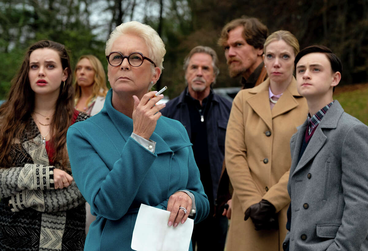 """This image released by Lionsgate shows Katherine Langford, from left, Toni Collette, Jamie Lee Curtis, Don Johnson, Michael Shannon, Riki Lindholm and Jaeden Lieberher in a scene from """"Knives Out."""" (Claire Folger/Lionsgate via AP)"""