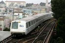 A Bay Area Rapid Transit (BART) train travels towards downtown San Francisco.