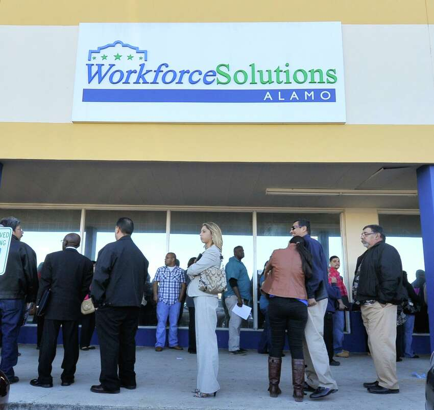 Job seekers wait in line to attend the Workforce Solutions Alamo job fair in 2014.