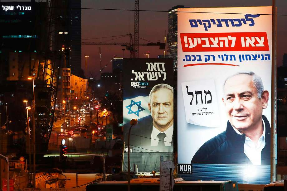 Billboards depict the portraits of Prime Minister Benjamin Netanyahu (right) and his rival Benny Gantz in Bnei Brak city. Photo: Jack Guez / AFP Via Getty Images
