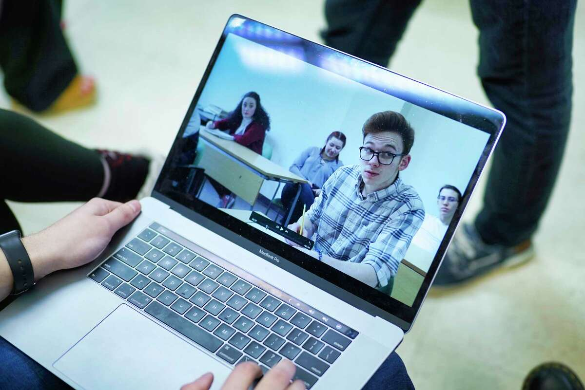 Questar III students look over video footage they shot earlier for a PSA on teen suicide prevention at The Arts Center on Wednesday, Feb. 26, 2020, in Troy, N.Y. (Paul Buckowski/Times Union)